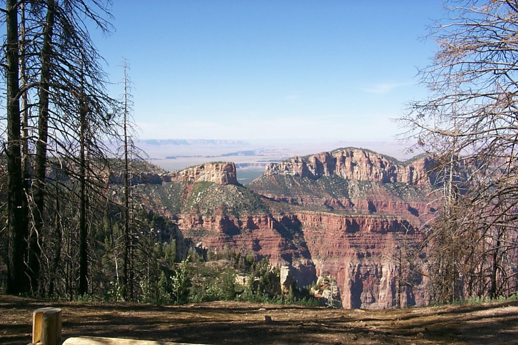 This picture shows more beautiful colour in a view directly east from the northern part of Point Royal. You can see the Colorado River meandering in a smaller canyon as it disappears in the distance at Marble Canyon. You can't actually see Marble Canyon but you can see the Vermillion cliffs in the distance which are just north and west of Marble canyon.