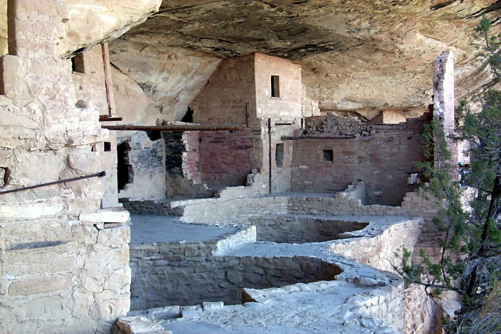 Here is a close-up of one of the dwellings. The open pits would have been covered with wooden roofs and these are the Kivas. The rooms with single entrance ways (doors not windows) would have been used for storage.