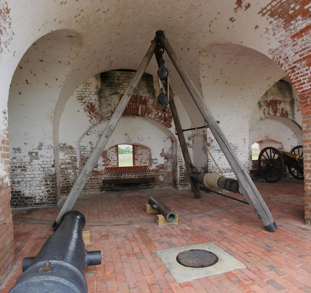 A cannon room with tripod and pulley system. The tripod/pulley system is used to lift cannon tubes onto their mounts.