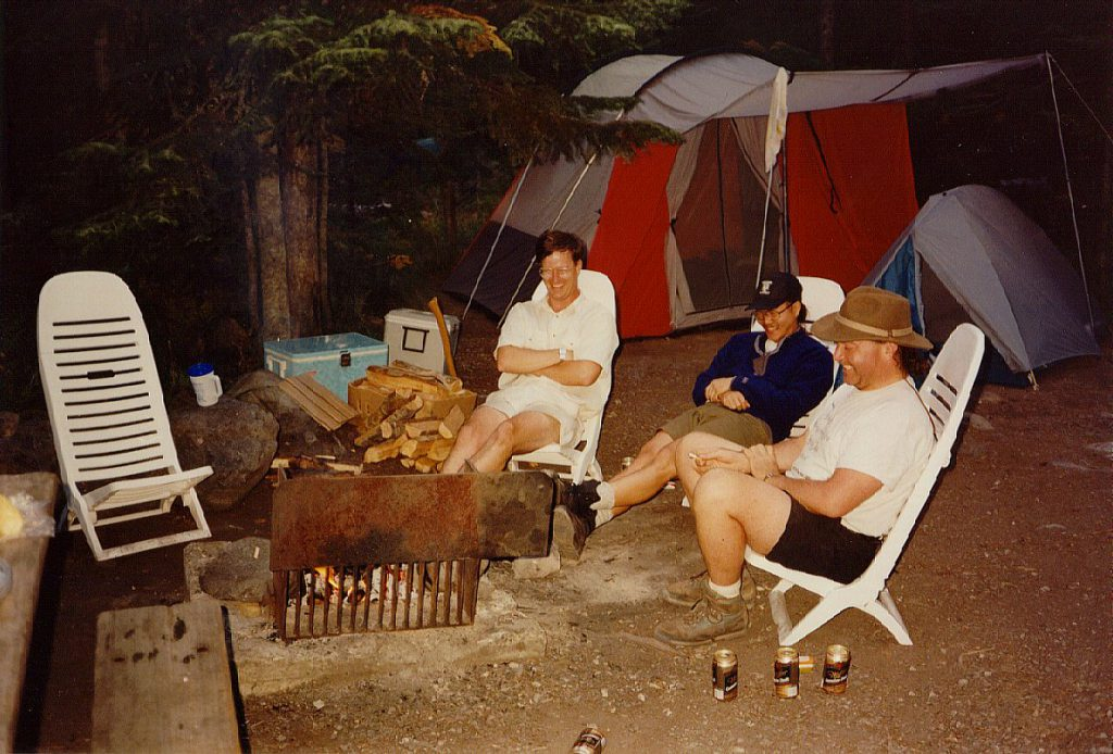 Of course, after any exercise comes the required beer fest. After festooning our campfire with dead soldiers we found something very funny. Strange though, no one can remember just *what* was so funny! Note the pile of firewood. The fellow who sold it to us did say it was a 'bit green' -- heck, it was less than 3 weeks since it was a nice big western cedar tree! It took a heck of a lot to get it burning but once it took it burned hot and long -- great for campfire cooking.
