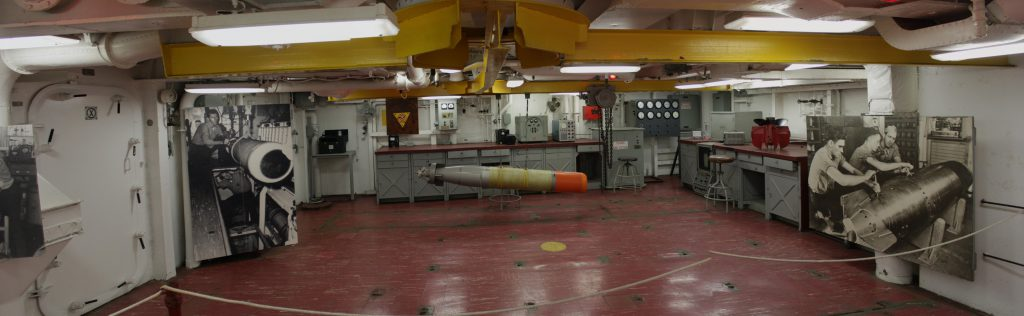 The torpedo bay for preparing torpedoes and sending them out to the plane hangers hung from the (yellow) I-beams.
