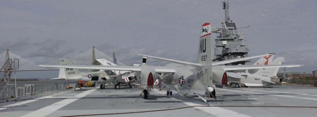 The top deck with several planes on display for viewing.