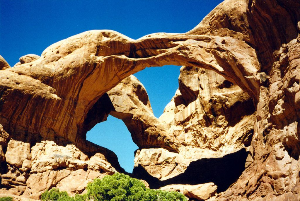 The area around the double arch is quite spectacular -- nearby there are a large number of arches and developing arches. Most of the arches in the park are found in this area and are carved out of the Entrada sandstone layer, which is exposed in this part of the park.