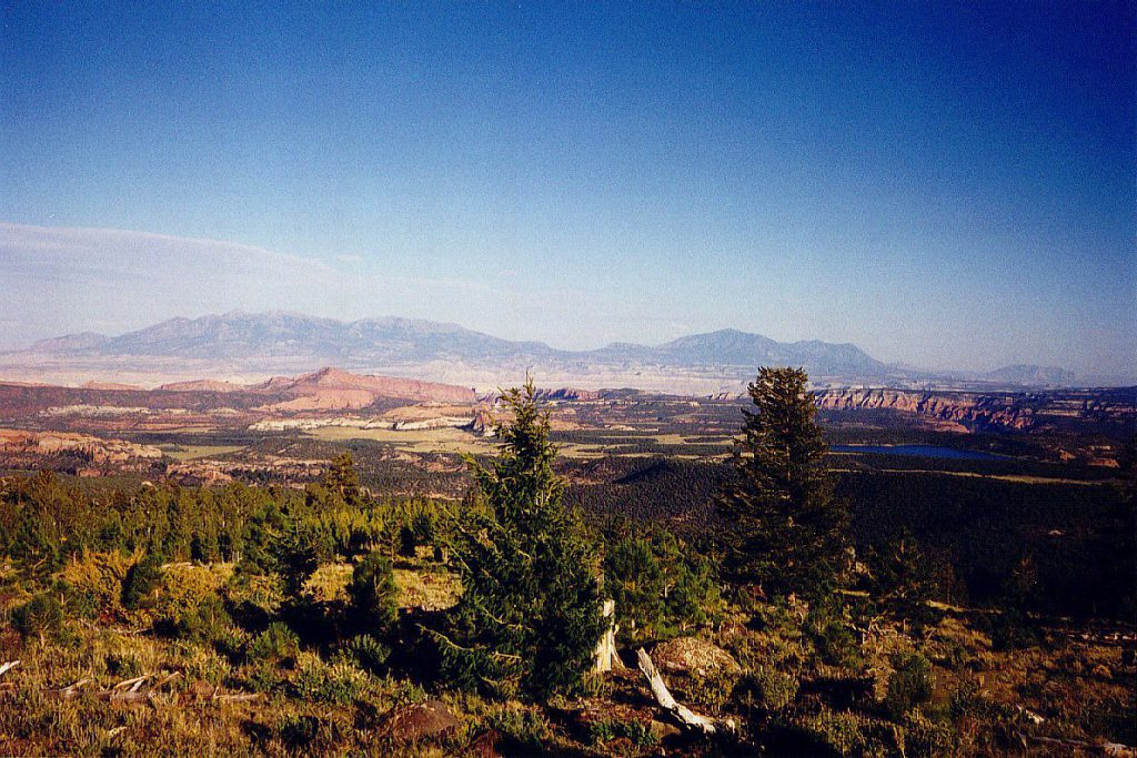 Looking north east from the Boulder Mountain you can see the setting sun light up the Capitol Reef on the left and the southward extension of the waterpocket fold on the right as well as the Henry Mountains in the distance.