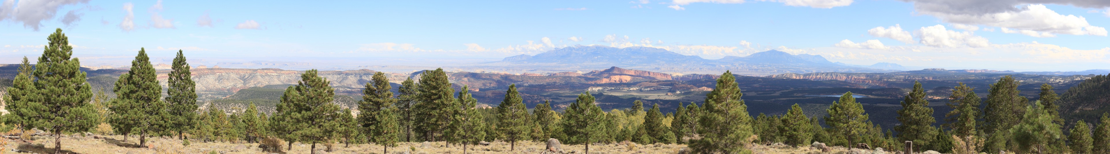 The View from Boulder Mountain. From US 12 on top of Boulder Mountain. The Capitol Reef (middle) and WaterPocket Fold (right) in the mid-distance with the Henry Mountains on the horizon.