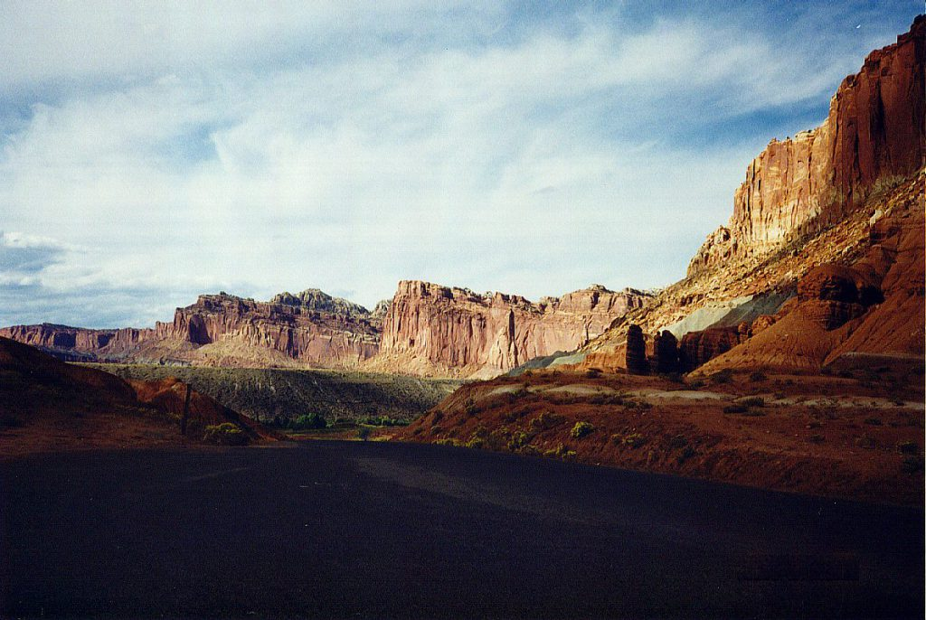 The Capitol Reef with the shadows cast by the setting sun and Boulder Mountain on the western horizon.