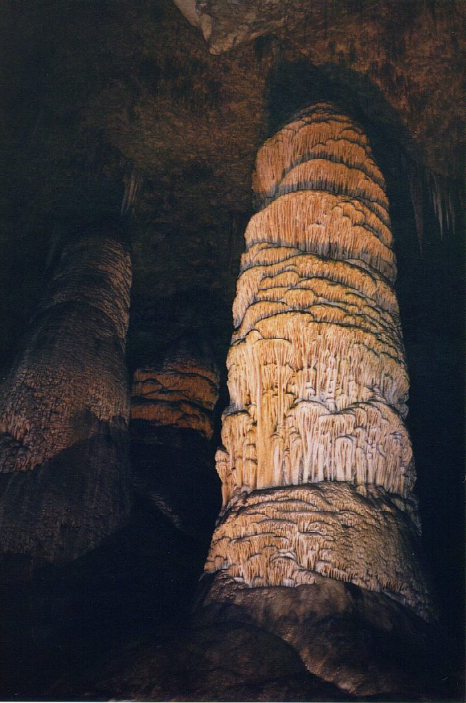 A beautifully illuminated giant stalagmite in the main cavern.