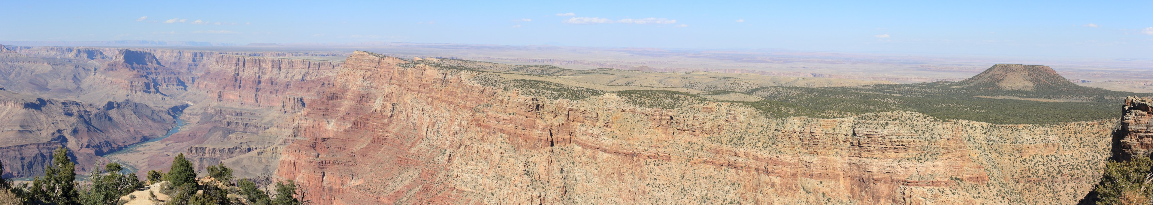 Desert View. With the Colorado on the left, the anticline to the Painted Desert in the distance, with a beautiful cinder cone standing out of the anticline on the right.