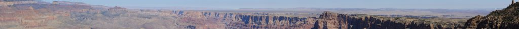 A Panorama from Navajo Point. This shot shows the north rim on the left, Wotan's Throne, Vishnu's Temple, Jupiter Temple, the Colorado and Little Colorado canyons, the anticline to the painted desert, and on the very right, the Desert View watch tower.