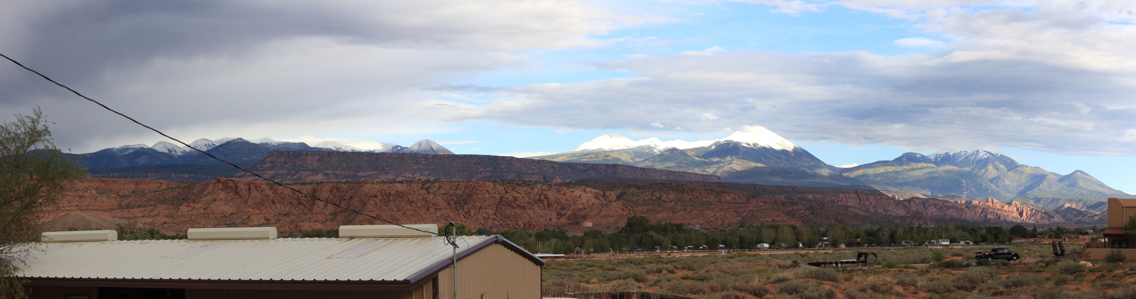 The La Sal Mountains. Taken from the KOA camp in Moab. There was no snow during the previous day, but it's quite visible now as the clouds (and weather) clear.