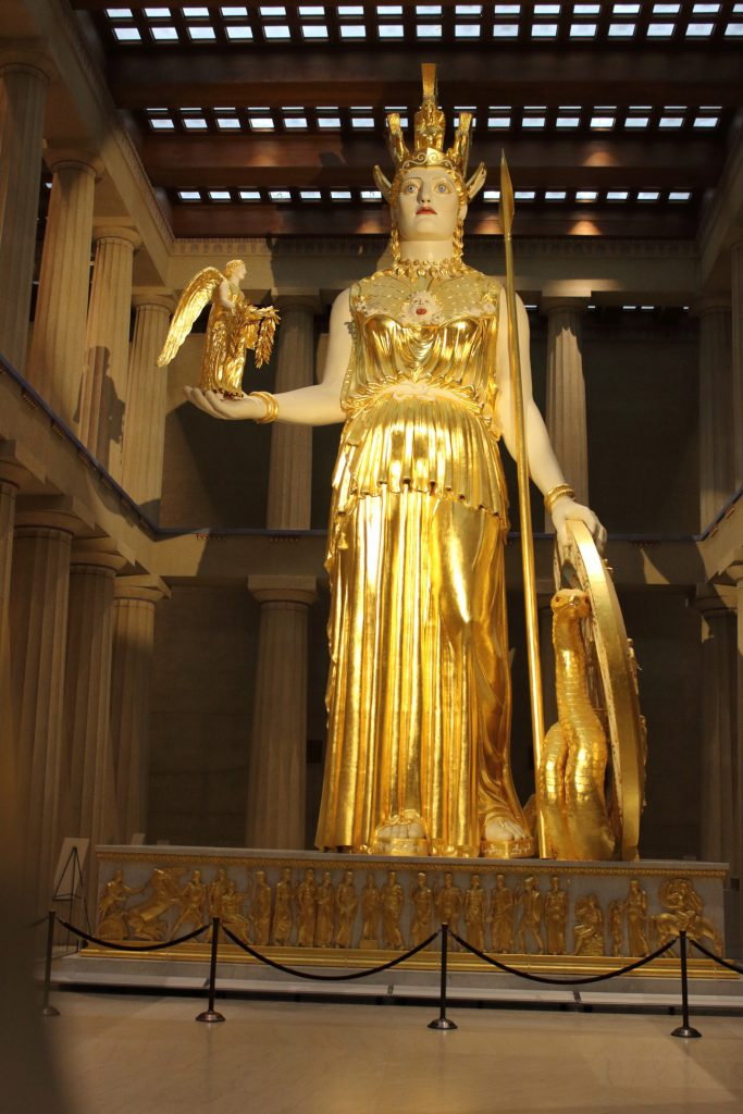 A statue of Athena with Nike on her hand.