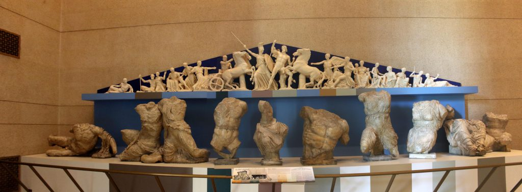 A model of one of the two frieze's adorning the top of the Parthenon. In the foreground are the representations of the classical statues used as the basis.