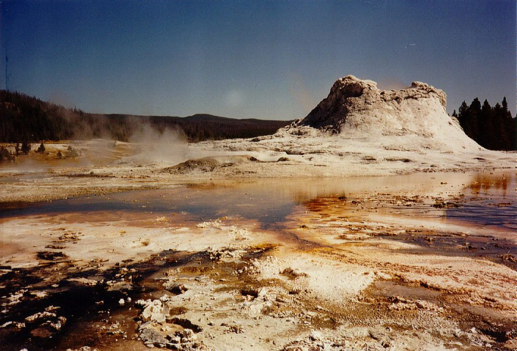 The Castle Geyser and accompanying alga pools in the Geyser Basin. Throughout the Geyser Basin and some other parts of the park you must be careful to walk on provided walkways -- the ground can break and you might find yourself falling into very hot water.